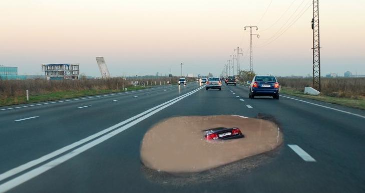 Pe DN1 a apărut o groapă atât de adâncă încât bucureștenii cred că au ajuns la mare și intră cu BMW-urile în ea