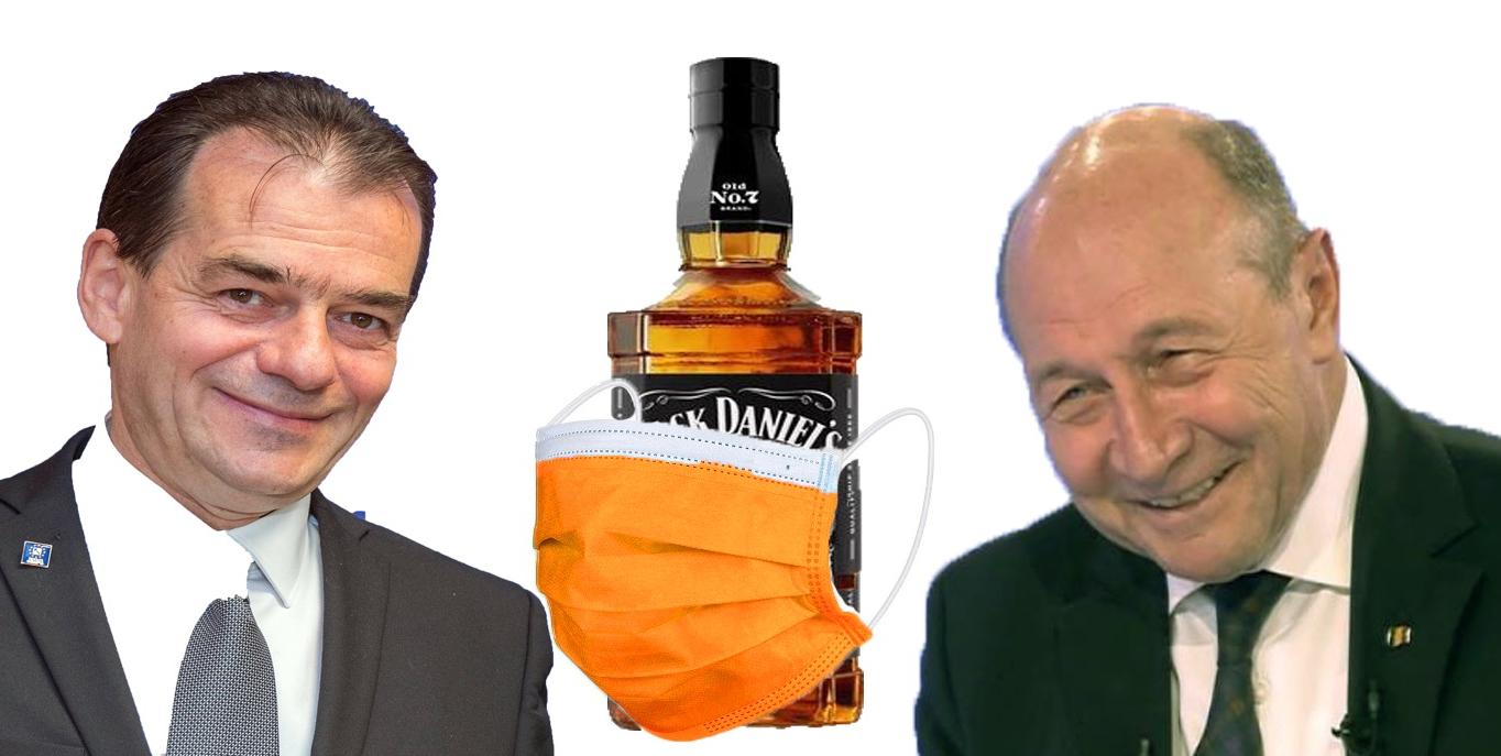 A apărut masca îmbibată în whisky, singura pe care ar purta-o şidomnii Băse şi Orban!