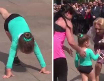 România sclavilor:Au forțat un copil de 3 ani să stea în cap pe asfalt ca să se bucure imunogloaba!