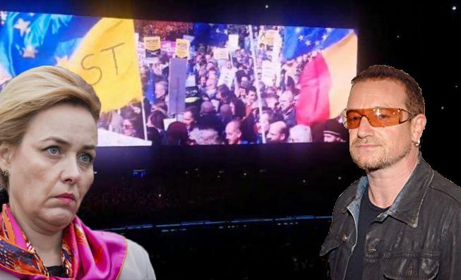 Sataniștii de la U2 proiectează la concerte imagini de la protestul din 10 august! Bono la pușcărie!