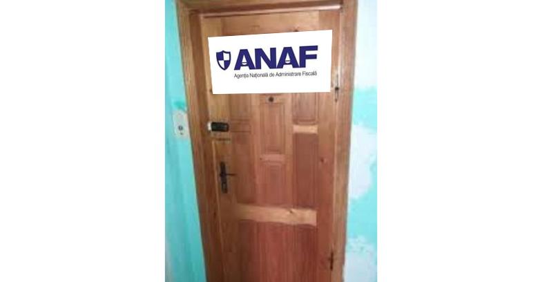 Un bucureștean și-a scris ANAF pe ușă ca să sperie popii!